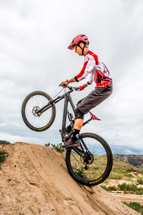 Cyclist going vertical on a hill.