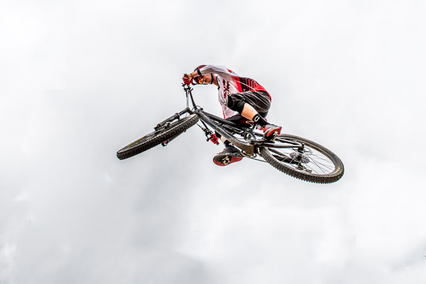 Catching air on a mountain bike - taken from below the cyclist.