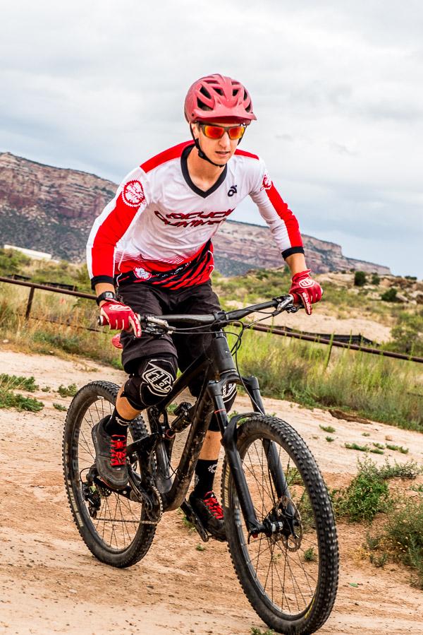 Senior photo on bycycle - action shot.