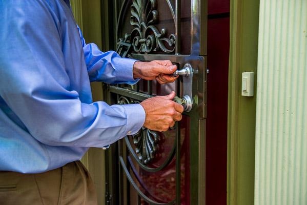 Hands unlocking a door.