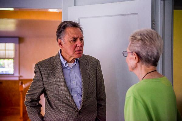 Man talks to an older woman.