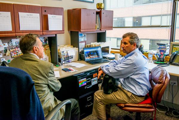 Two realtors in ofice talking.