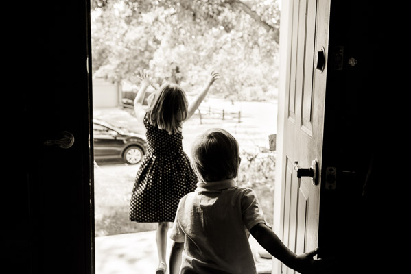 Silhouette of kids running out the front door.