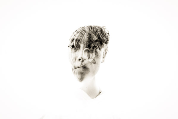 Boy with two ears over his face double exposure
