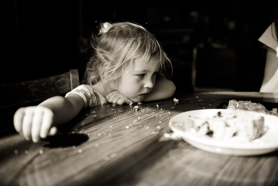 girl at a table covered in crumbs