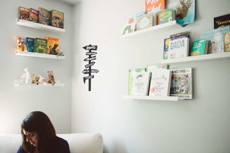 in-home newborn photos denver mother in her harry potter themed nursery