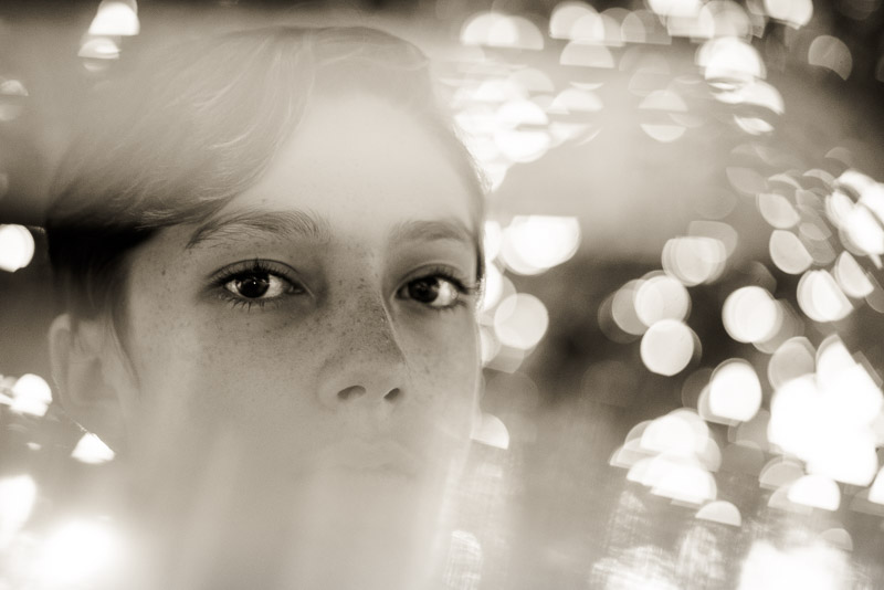 color or black and white photo of boy with bokeh