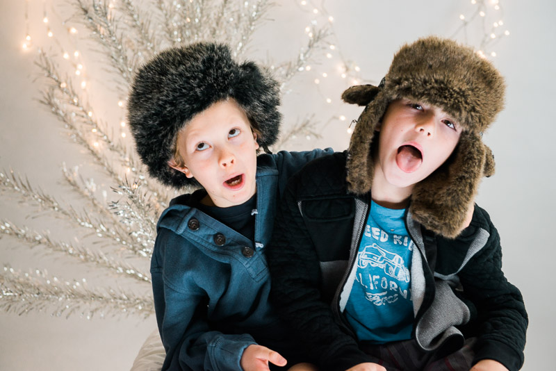 christmas card studio sessions two boys in fuzzy hats being silly