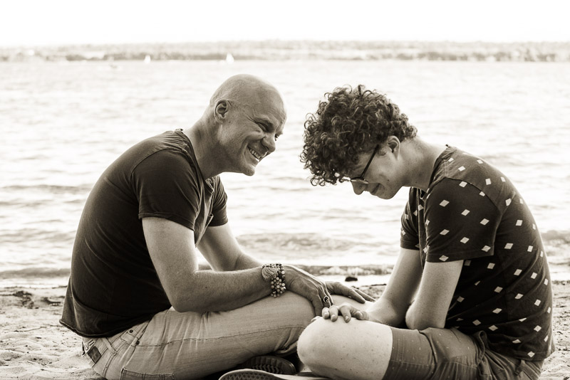 father and son connecting on the beach