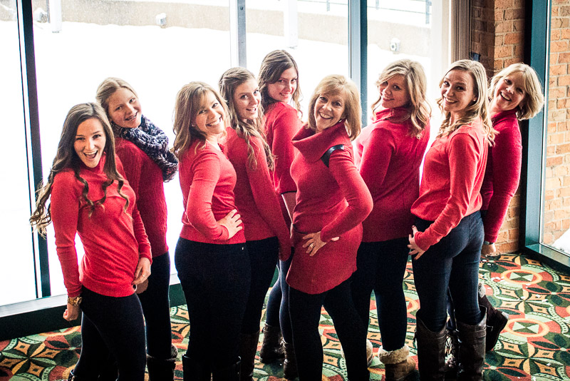 All the women in maatching red sweaters