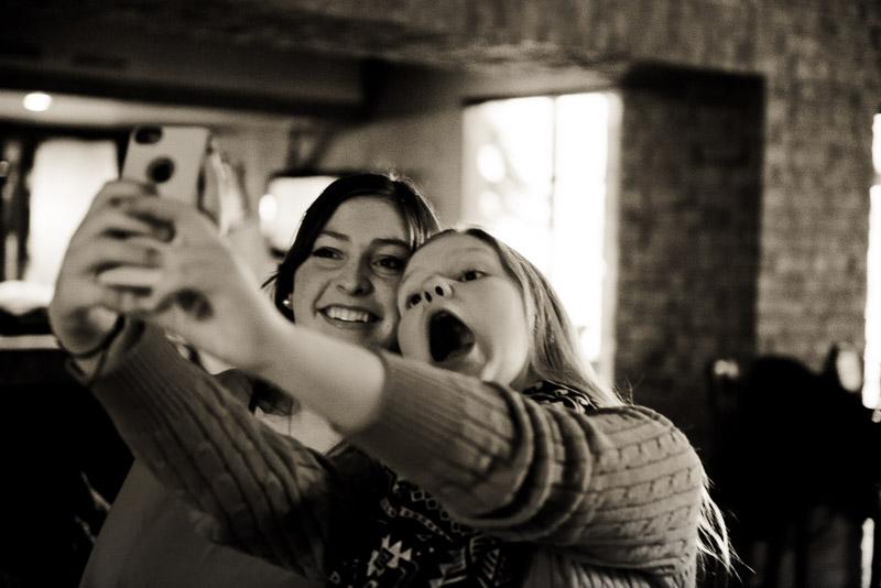 Two girls taking a selfie.