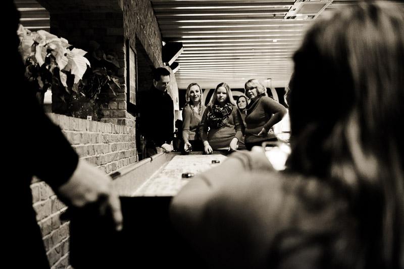Family playing air shuffleboard