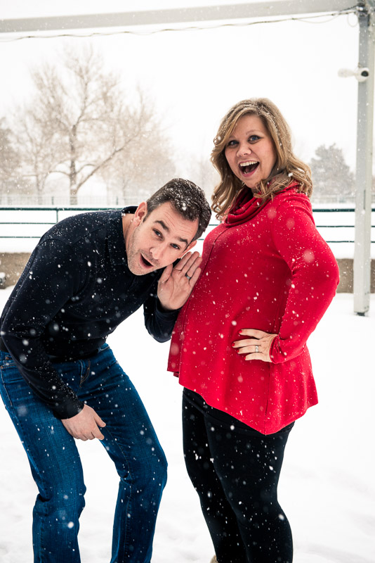 Silly photo of man listening to his pregnant wife's belly