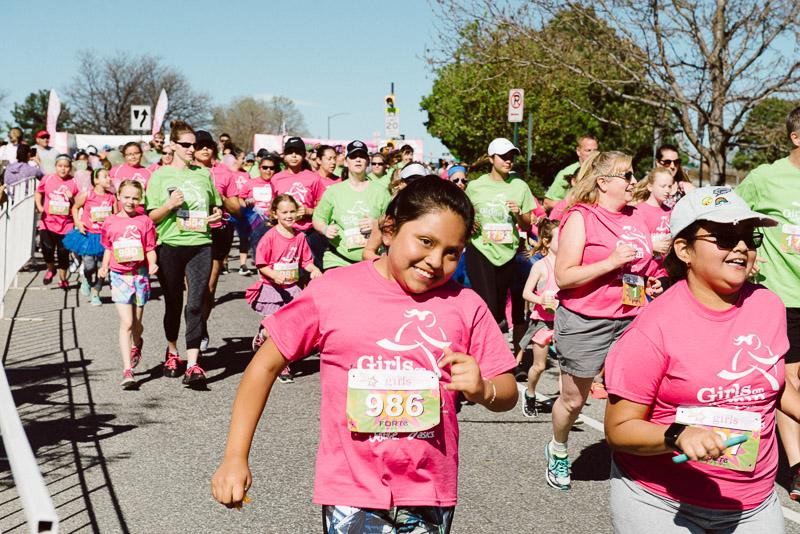 girl running in the girls on the run 5k race