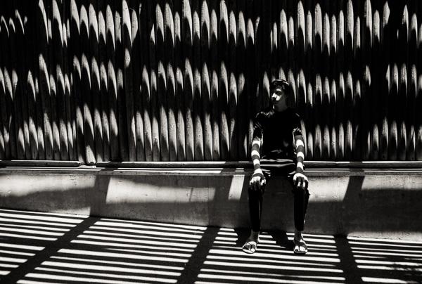 Senior boy in unique shadowy location in Denver, Colorado