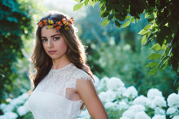 Beautiful senior girl wearing butterfly crown in her senior photos