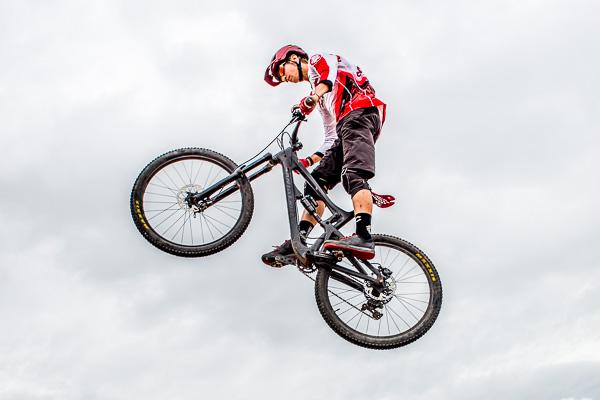 High school senior boy jumping his bike in his senior picture