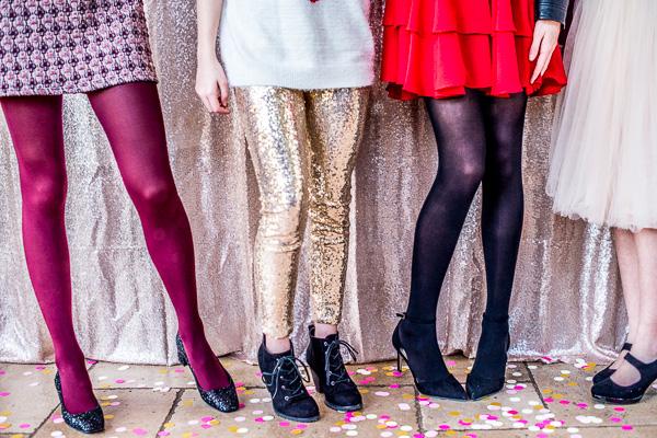 Legs of teen girls in fancy clothes.