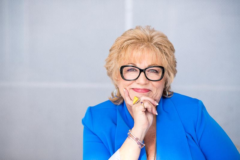 Cute branding photo of a woman wearing great eyeglasses