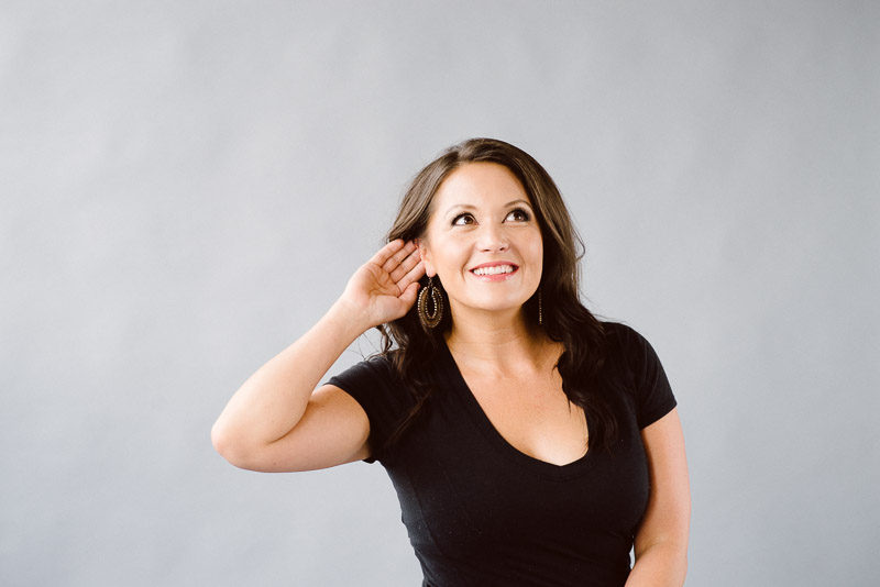 Woman demonstrates listening for feedback from a client.