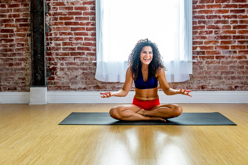 PHoto of yoga teacher smiling and laughing