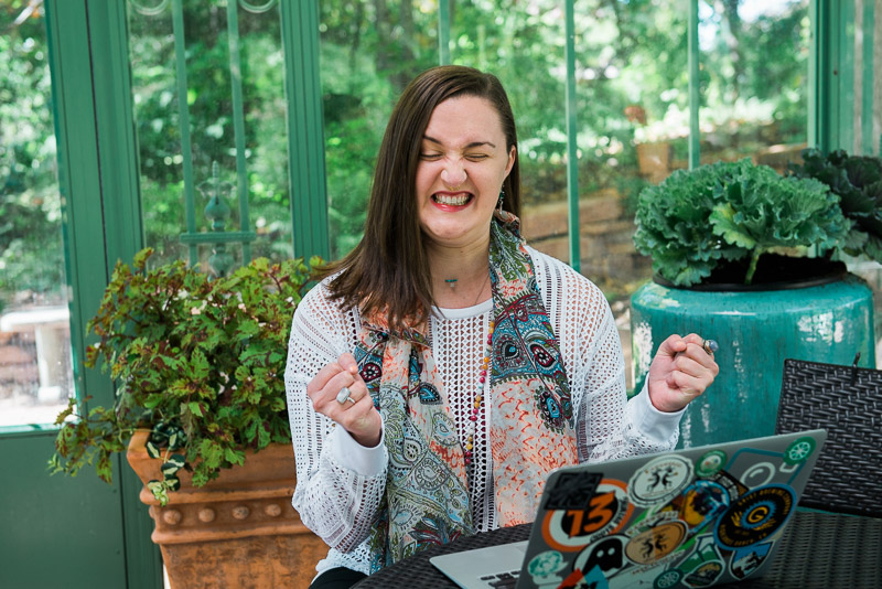 Photo of woman business owner frustrated with something she sees on her computer screen