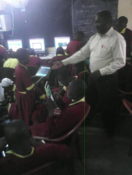 Mr Ng'ang'a with standard 6 pupils in the computer lab