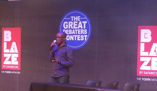 Ernest of the iMlango field team addresses the crowd