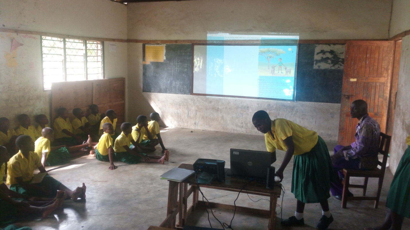 Pupils access and read Africa-focused stories on the learning platform during a whole-class learning session at Kwaupanga primary school