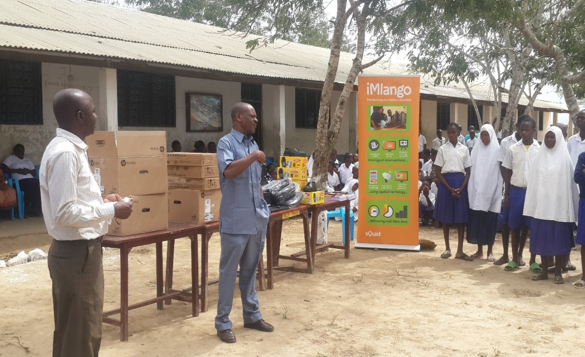 Headteacher (left) Mr Geresa Motto, and Community Support Officer of Mariakani (right), Mr Chimbungu Mwarumba address pupils and congratulate the winning group.