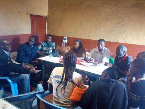 The iMlango team with group members, June 2018