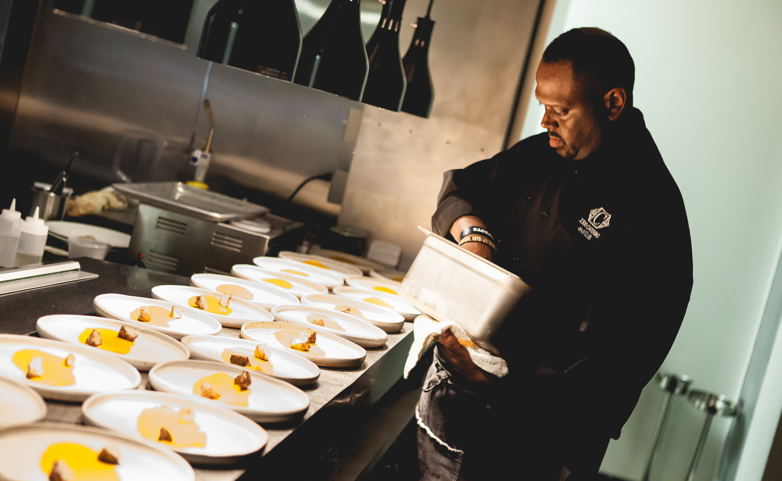 Chef Michael Hall, of Spoonbread Bistro in Richmond, plates food for the first John Dabney Dinner.
