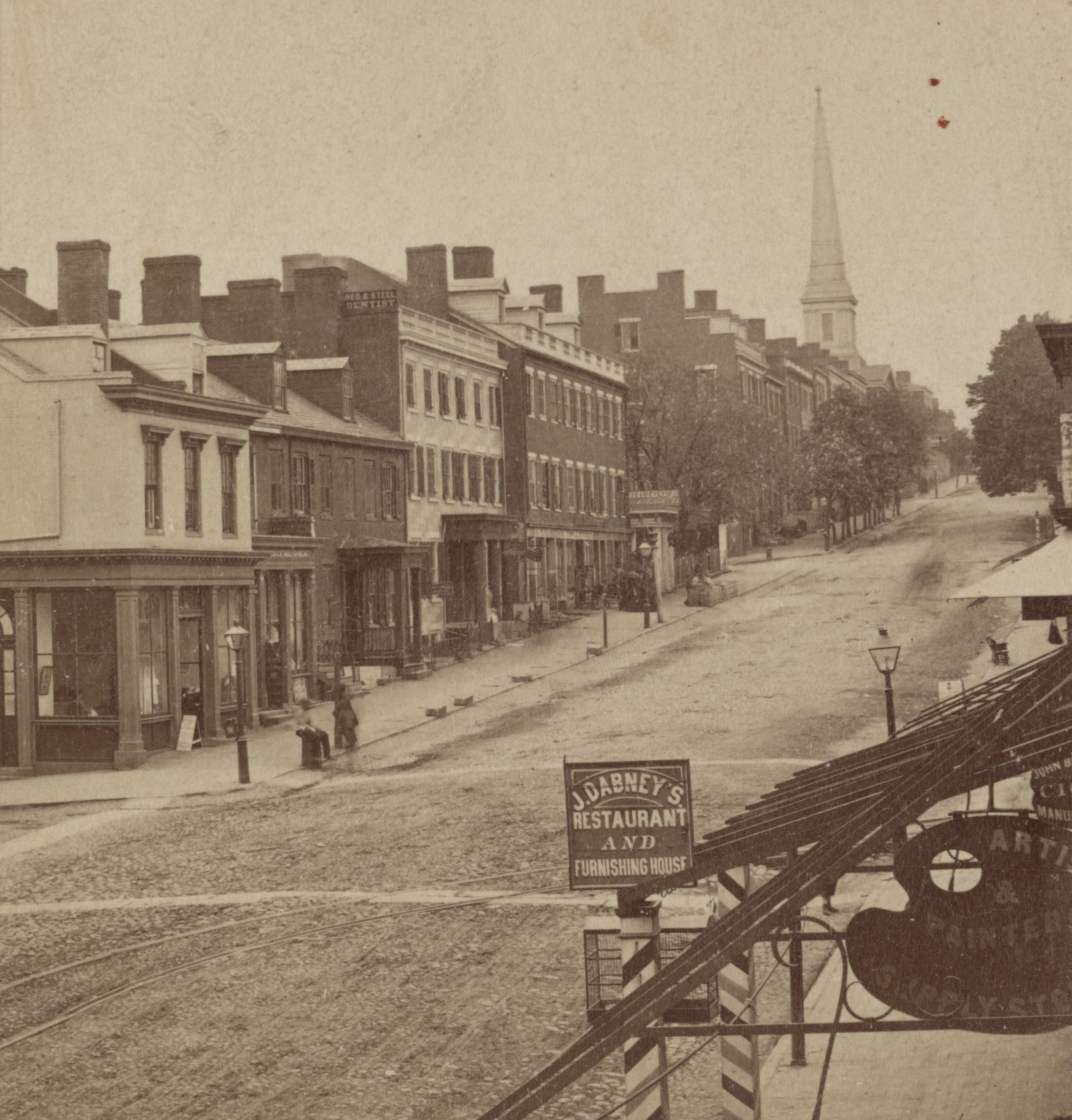 This image of Richmond's East Main Street, looking west from Eighth Street, shows the sign for one of the several restaurants opened and operated by John Dabney.  It is the only known photograph of an establishment owned by Dabney.   (Library of Congress)    Click the image to enlarge.