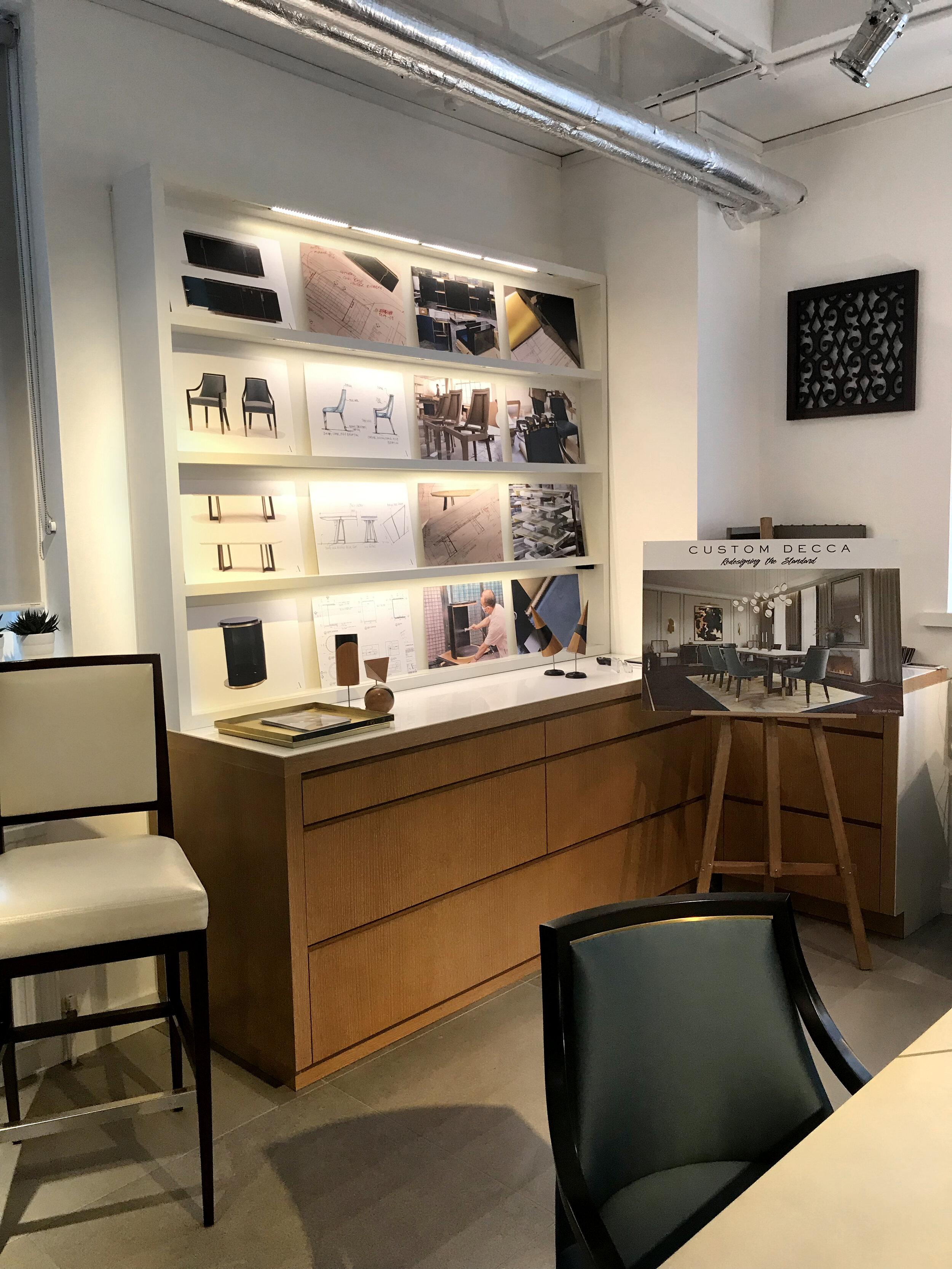 A display showing the final sketches and 3D renders of the Accouter Collection
