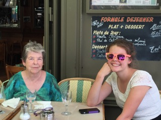 Mom in Paris with Archer, sharing her love of travel.