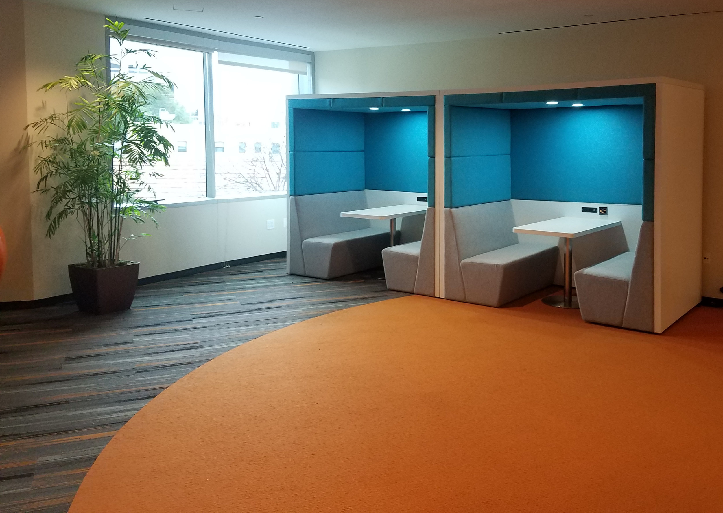The Hive cafe and office meeting Booth  Meeting pods allow people to have meetings, brainstorming sessions, and private conversations without disturbing the whole office.