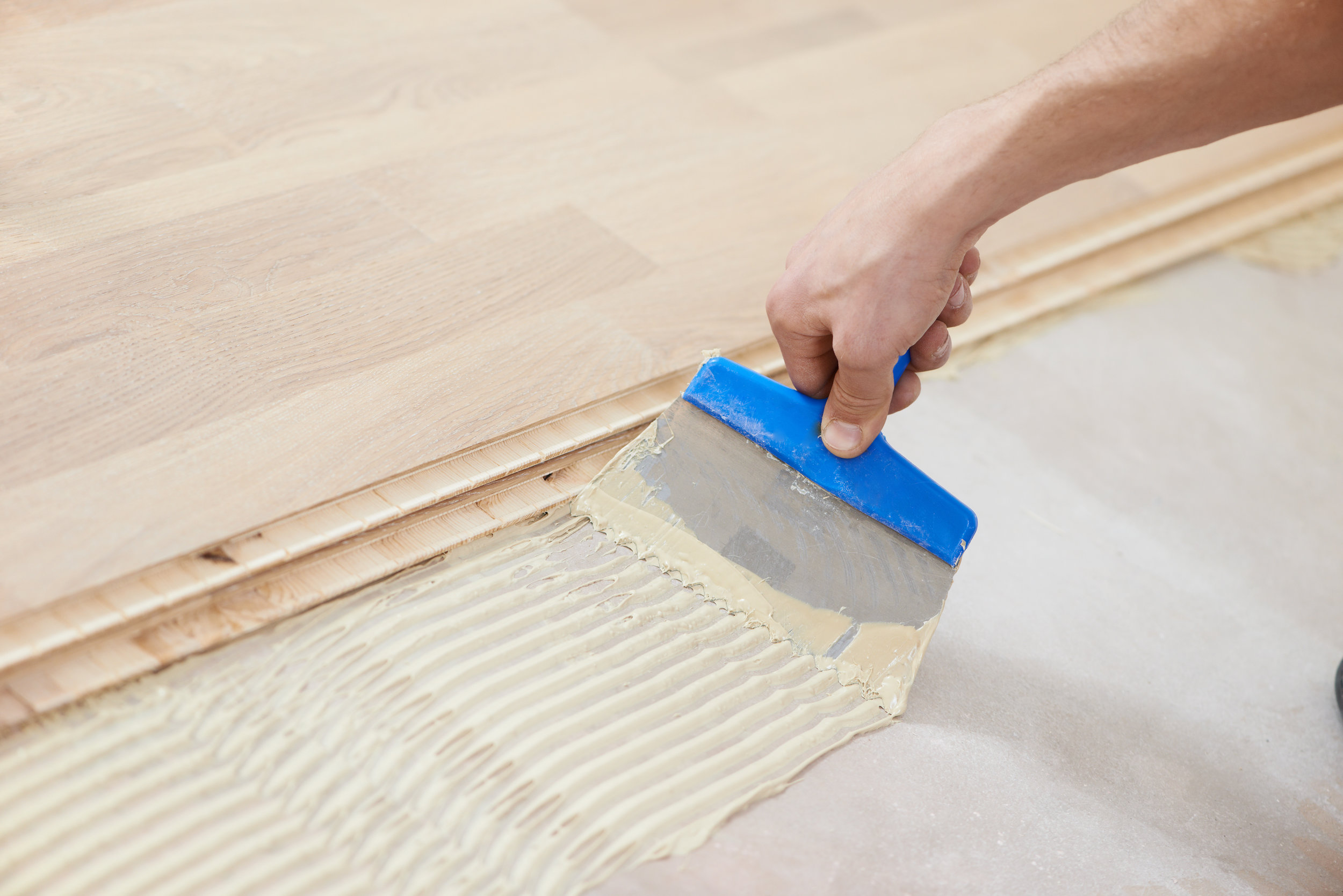 Wood Flooring, What Adhesive To Use For Laminate Flooring