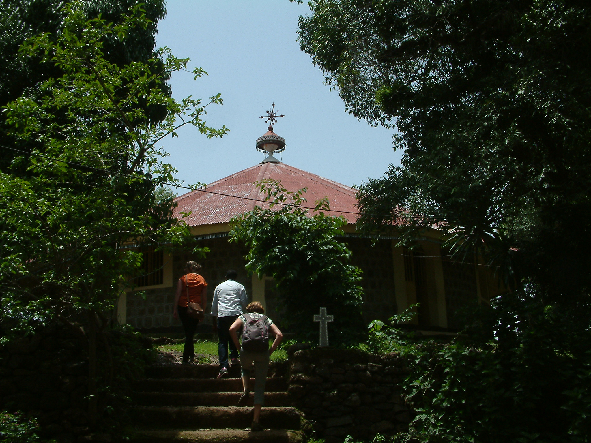 walking tghrough the coffee trees to one of the monastries.JPG