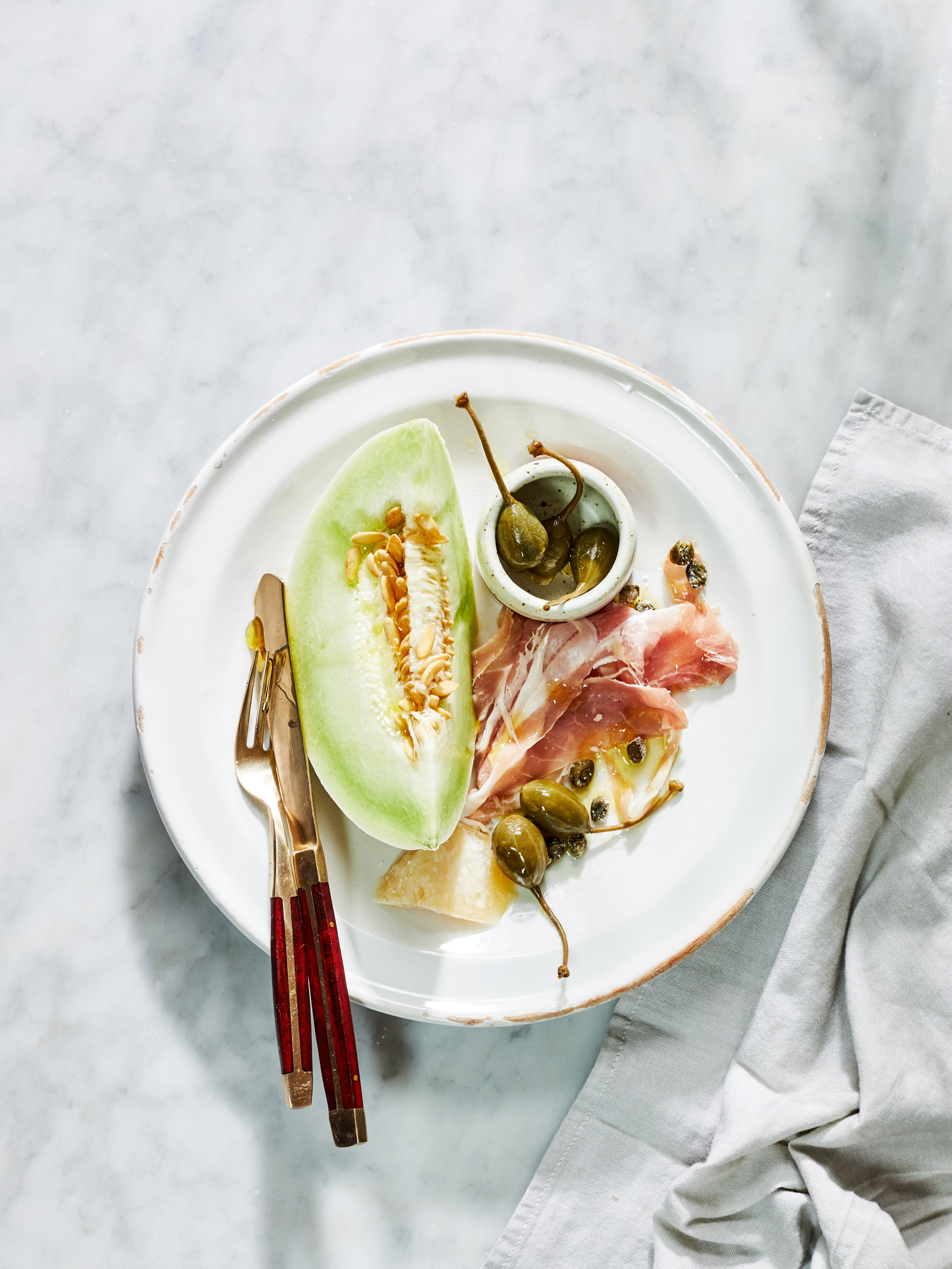 PROSCIUTTO AND MELON WITH KALE AND CAPER BERRIES (PLUS FOUR HOT RESTAURANTS IN ROME) #sarahcopeland #edibleliving #prosciuttoandmelon #foodstyling #easysalad