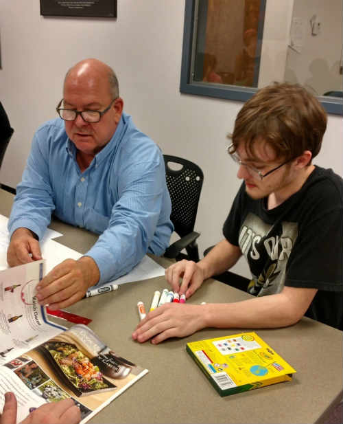 A mentor spends time with a participant in the Career Connections Wood County mentor night program.