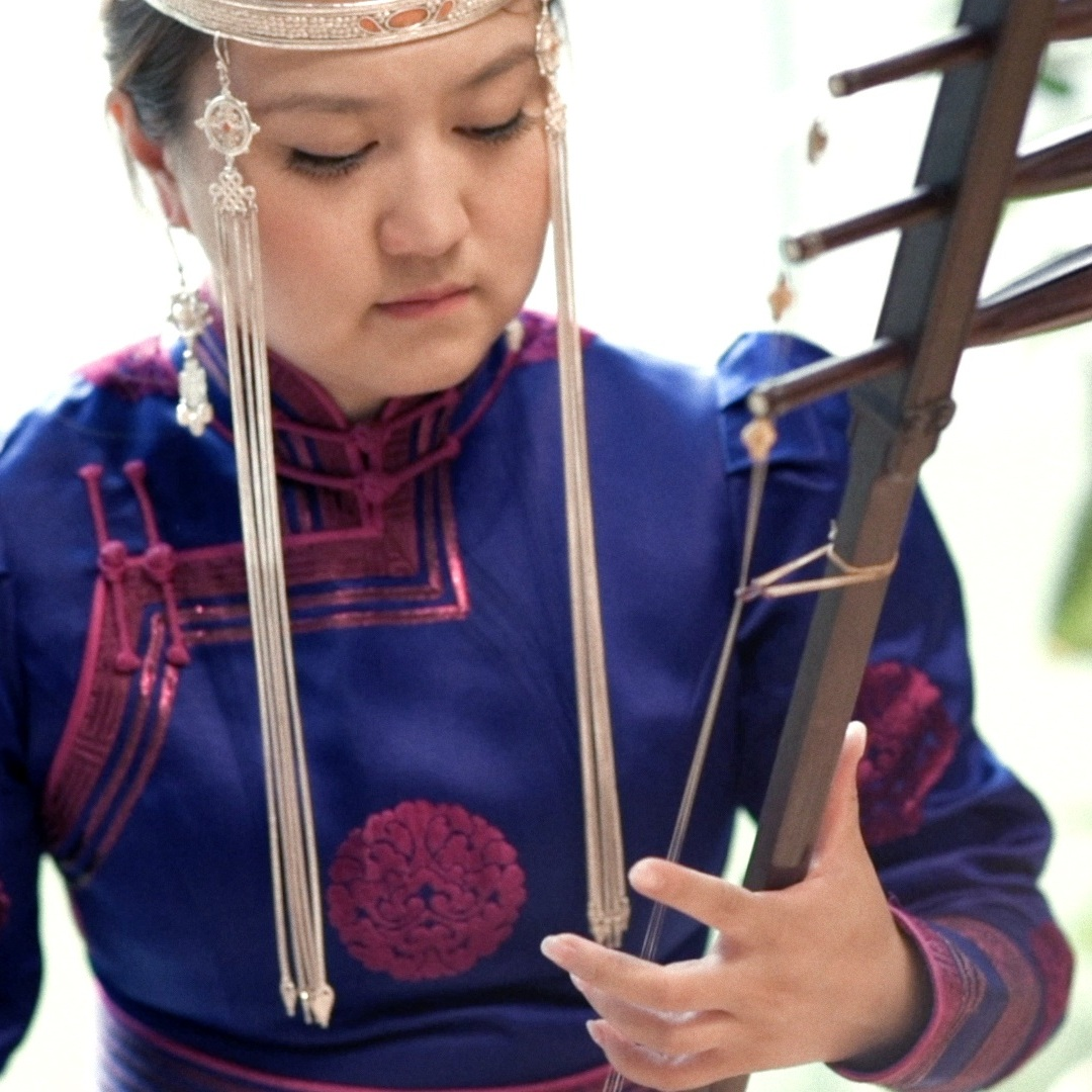 Suya - A virtuoso of the Sihu, a bowed string instrument played in various musical traditions of Inner Mongolia, China.