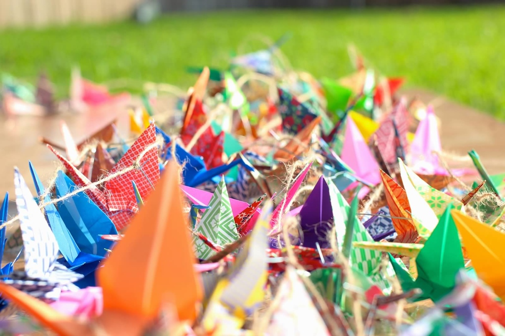 Worked with friends and family of the couple to fold thousands of paper cranes which were strung with lights across the backyard. Photo by Michael Atkinson