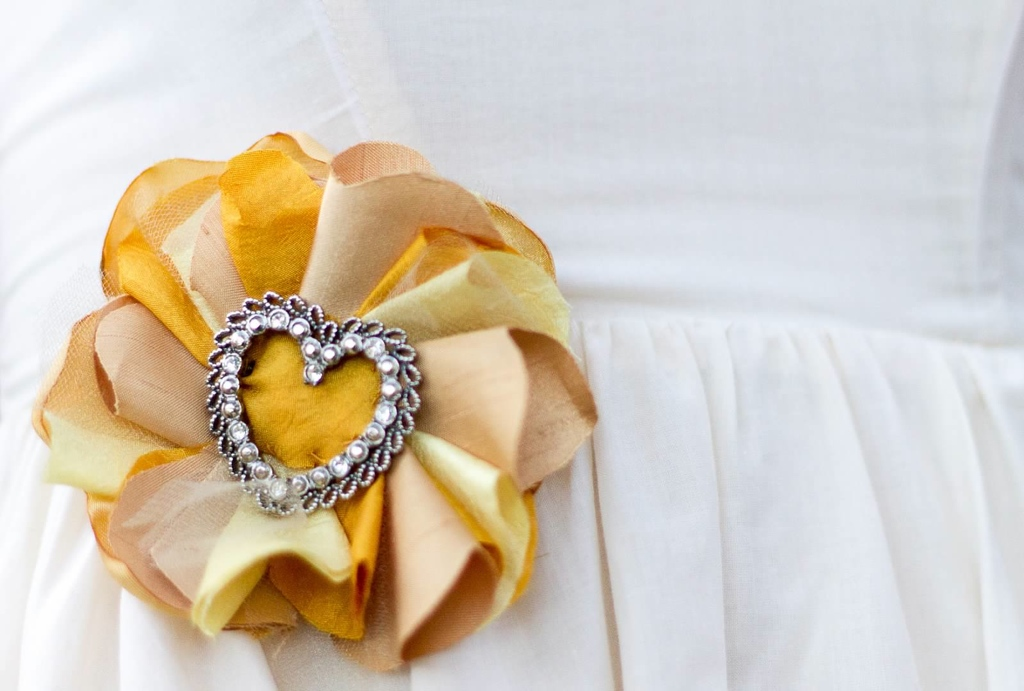The bride's silk and crepe flower with an heirloom brooch. Photo by  Heather Raeburn Photography