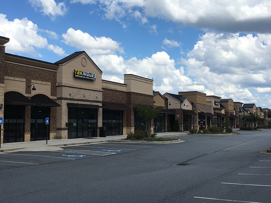 shopping-centers-villagev-retail-vision-development-construction-atlanta-georgia-commercial-general-contractor-design-build-site-assessment-tenet-build-own-agent-full-services