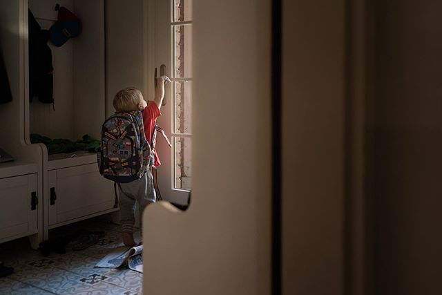 """This little guy wants to join his brothers at school SO badly.  Yesterday morning he got a backpack on by himself and went to the mudroom door to try and escape, barefoot.  He kept saying, """"Baby school!"""" Poor little man.  Join me in my breakout to learn to take environmental portraits like this!  Link in profile!⠀ .⠀ .⠀ .⠀ .⠀ ⠀ #clickinmoms #clickmagazine #clickpro #letthekids #cameramama #documentyourdays #dearphotographer #dearestviewfinder #nikonnofilter #cmmentor #thephotographersnotebook #clickinmomsmentor #sigmabeauty #sigma35mmart #backtoschool #letthembelittle #clickphotoschool"""