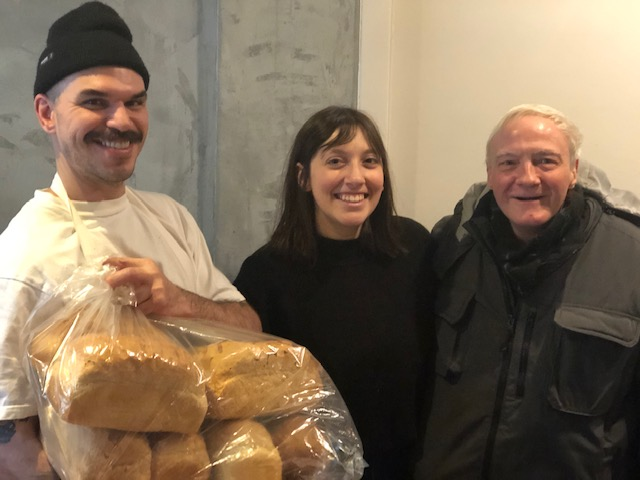 Owner Peter Simard and manager Paula of WELL Resto on Wellington with Patrick Coveny, volunteer at SouthWest. Peter made a donation of fresh baked bread for the Welcome Wednesdays every week of December.