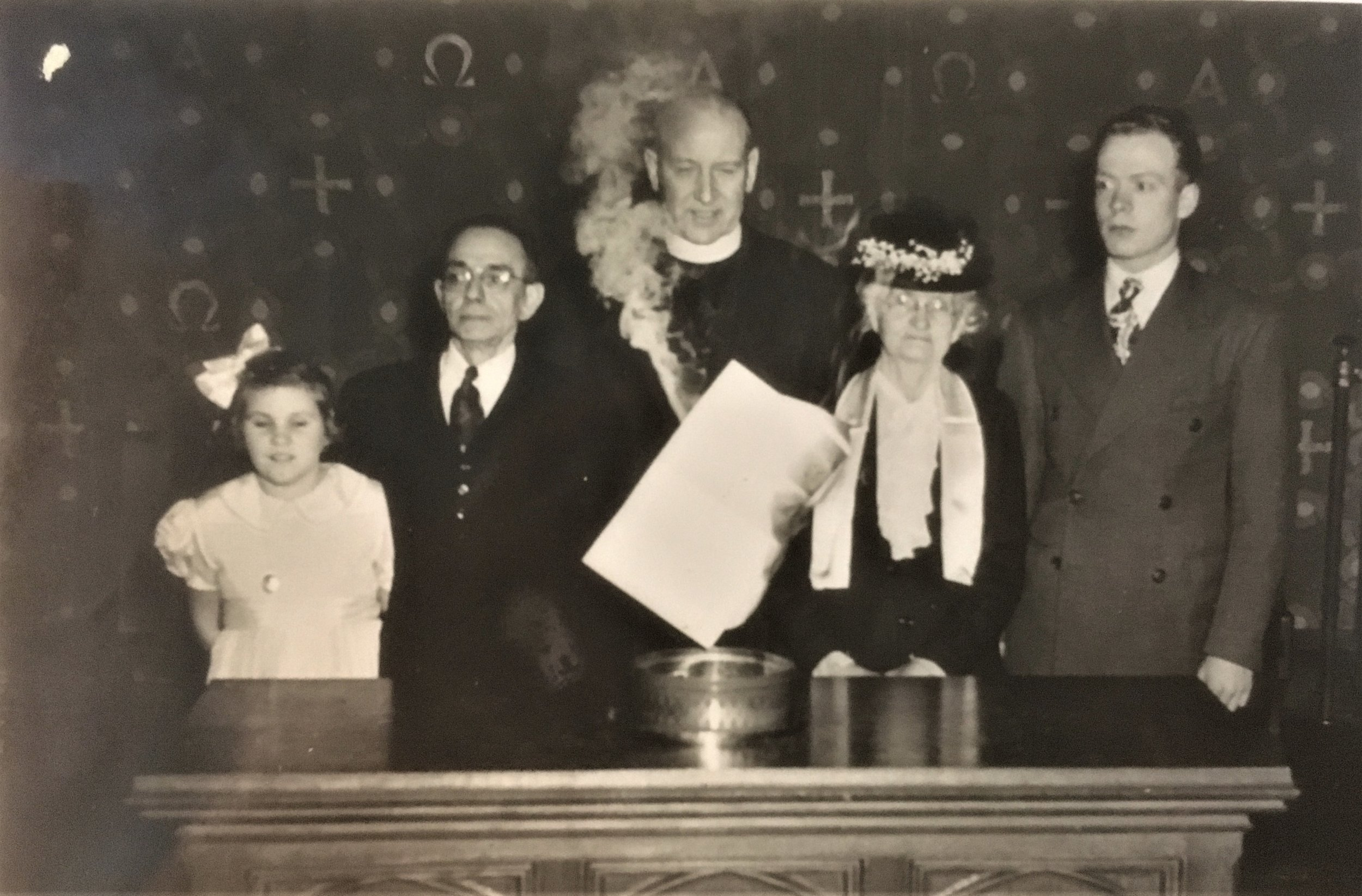 Rev. Joyce sets fire to the mortgage deed, surrounded by (L to R): Marjorie Cooper, representing the Sunday School; Mr. Harris Way, Clerk of Session; Mrs. Clement King, oldest living member; and James Goodwin, representing Church Youth. 1947