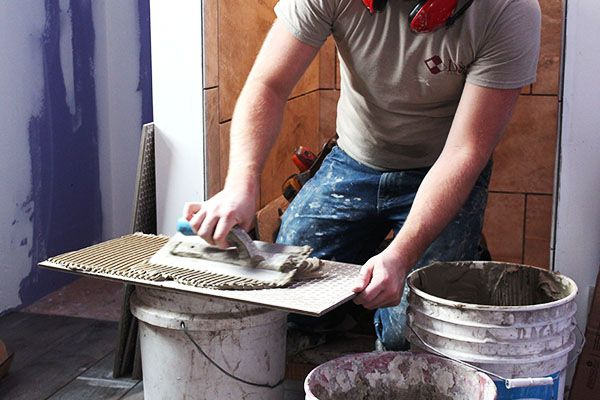jordan-weaver-residential-tile-install-shower-trowel-mud-compressor.jpg