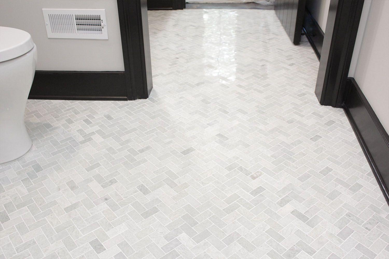 IMG_5314-bathroom-tile-floor-herringbone-residential-d-and-s-flooring-compressor.jpg