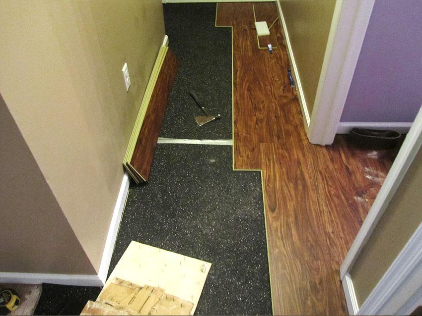 mike-marinari-kulick-lvp-carpet-on-stairs-13-during-rubber-underlayment-d-&-s-flooring.jpg